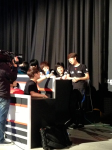 Jjakji smiling and talking with his team after his victory over MMA